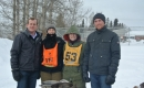 Trent Wotherspoon with volunteers and racers at the Canadian Dogsled Championship