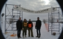 Trent Wotherspoon with racers and volunteers at Canadian Dogsled Championship