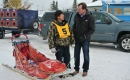 Trent Wotherspoon speaking with a dogsled racer