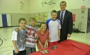 Trent Wotherspoon with students and tiles at Shannen\'s Dream