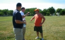 Trent Wotherspoon with Maritn football coaches